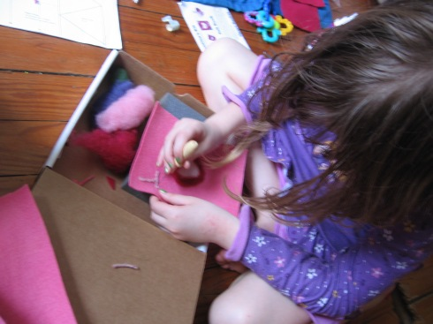 Deladis working on a cover for her Valentine box.  Single needle felting.
